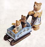 She-bear sledging two bear-cubs